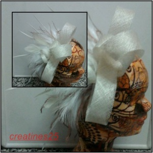 mosaico tocado beis plumas